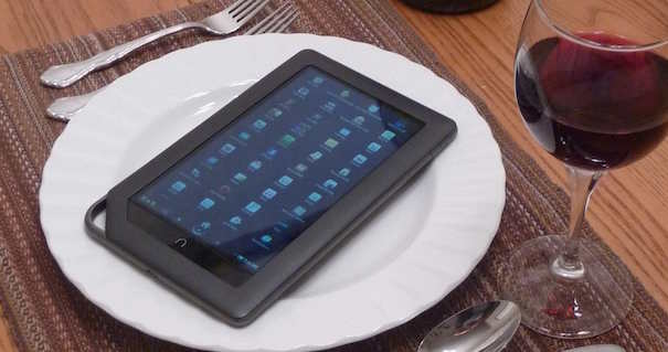 iPhone on plate at dinner setting