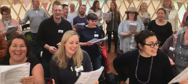 Group of singers enjoy singing together in a yurt